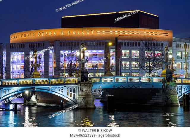 Netherlands, Amsterdam, Amsterdam Music Theater on the Amstel River, dusk