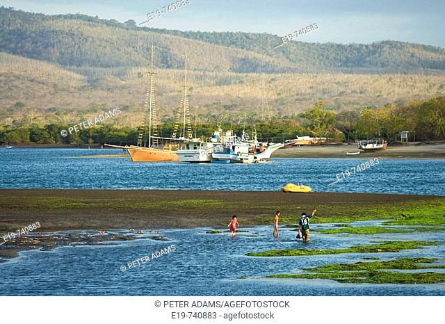 Gilimanuk, Bali, Indonesia. Bay with boat & children