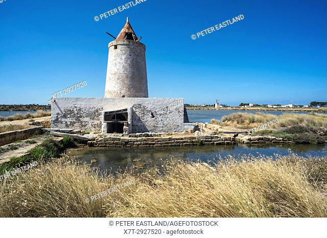 Saltpans and derelict windmill at the Salina Grande wildlife Reserve near Culcasi, south of Trapani, on the west coast of Sicily, Italy