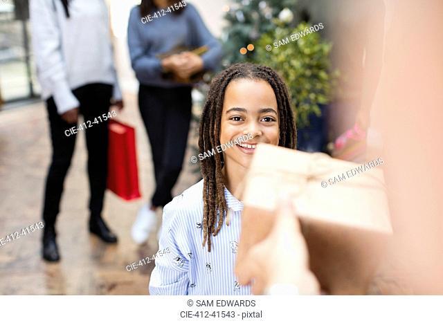 Smiling girl receiving Christmas gift