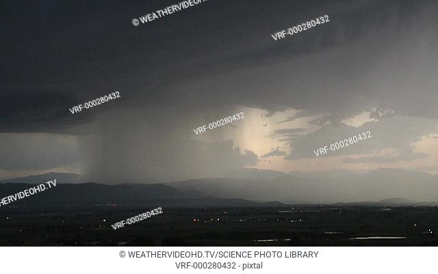 Timelapse footage of an intense thunderstorm moving off the Rocky Mountains onto the plains.The storm has a prominent column of rain surrounded by numerous...