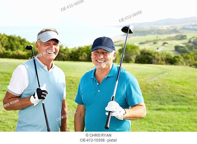 Smiling senior men on golf course
