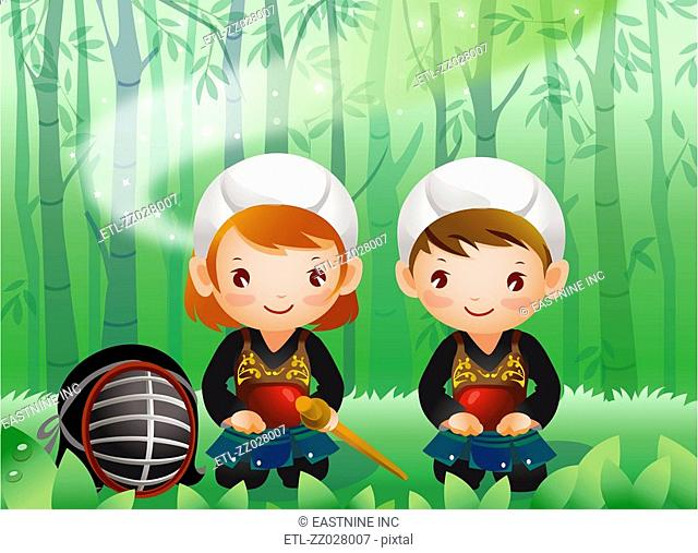 Portrait of a boy and a girl wearing kendo uniform sitting in the forest