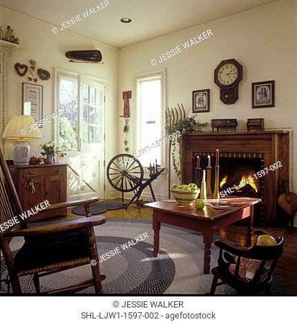 LIVING ROOM - Country Living Room, wood mantel, fireplace, wall clock, painted red coffee table, rocking chair, braided rug, wood floors, child's chair