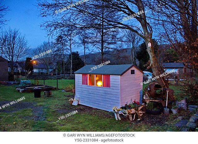 Llanberis, Wales, UK - 30th December, 2014. UK weather - A warm glow coming from a garden shed as the temperature plummets outside in Llanberis, North Wales