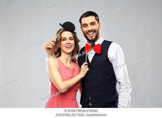 couple with party props having fun and posing