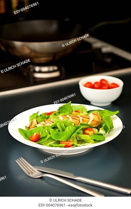 Sliced chicken breast as salad ingredient