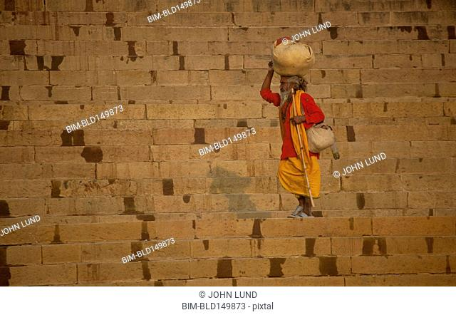 Indian man carrying bundle on his head