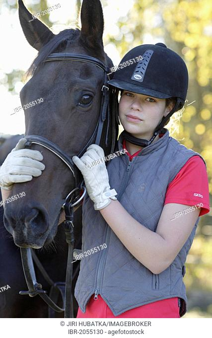 Young girl, 17 years, with her horse