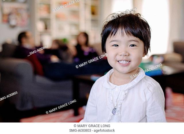 USA, Portrait of girl (2-3) in living room