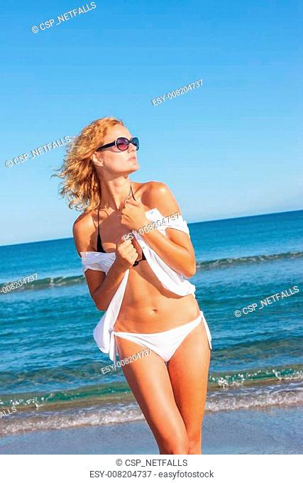 Woman in white shirt on the beach