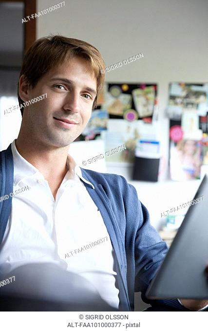 Man using digital tablet in office