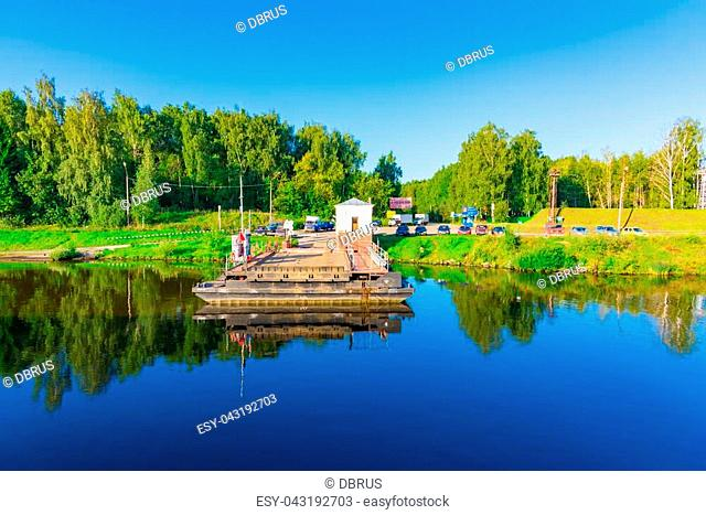 Russia, the Moscow channel, August 27.2016. car pontoon periprava through a reservoir in the summer. Transport awaits its arrival