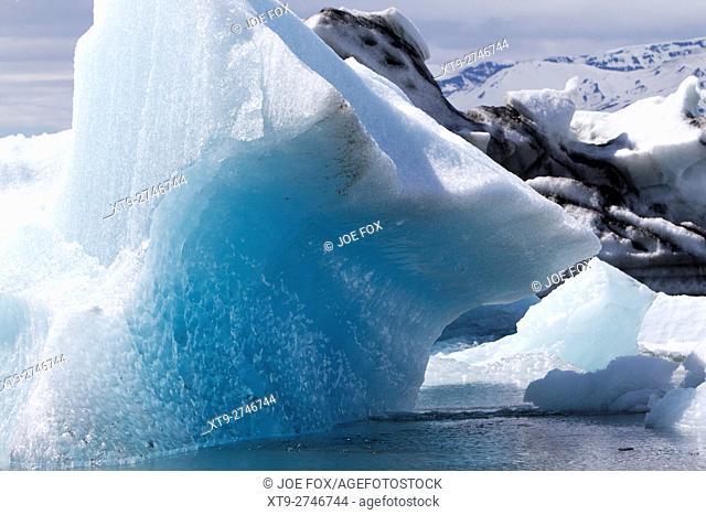 water moulded blue ice iceberg at Jokulsarlon glacial lagoon Iceland