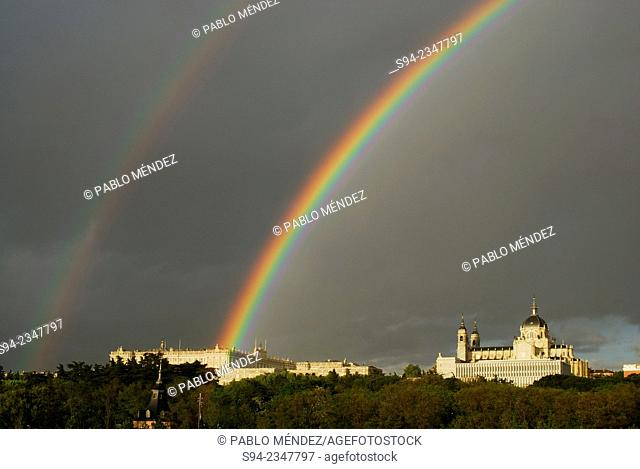Almudena's cathedral and Royal palace with a rainbow in the sky of Madrid, Spain