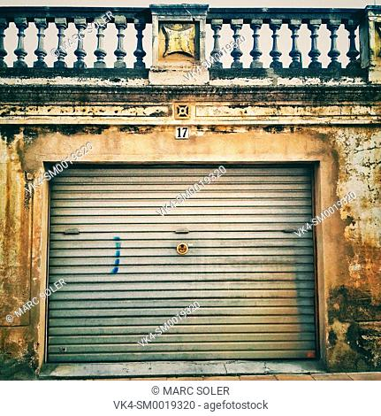 Door of a warehouse with blinds drawn. Barcelona province, Catalonia, Spain