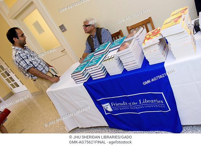 """Bengali Indian author Amitav Gosh signs copies of his novel """"""""River of Smoke"""""""" after reading from the book at Johns Hopkins University's Homewood campus in..."""