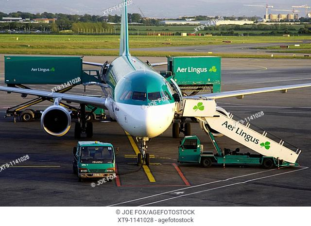 close up of front of Aer Lingus Airbus A320-211 EI-CPG St Aodhan sitting on the apron with steps and aer lingus van being loaded at dublin airport