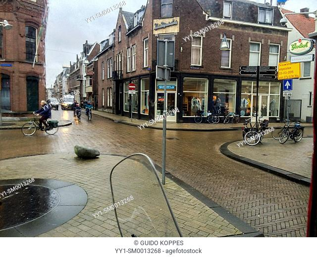 Tilburg, Netherlands. Intersection between several down town streets, during a rainy winter afternoon