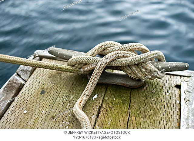 Rope tied around cleat in Crescent Harbor, Sitka, Alaska, USA
