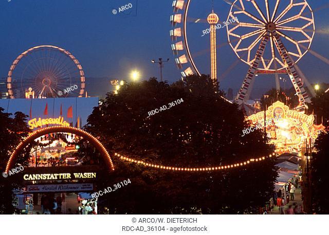Merry-go-rounds at public festival at night Cannstatt Stuttgart Baden-Wurttemberg Germany