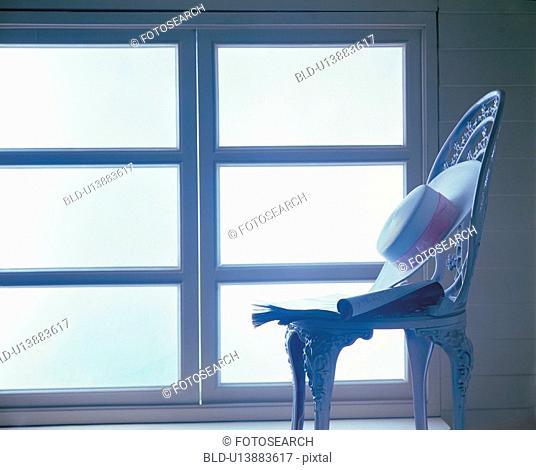window, object, megazine, hat, chair, film