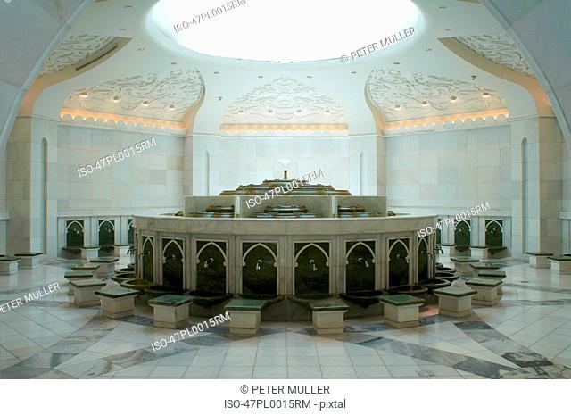 Ornate monument under mosque skylight