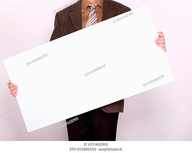 Advertising concept. Businessman holding blank sign empty billboard pointing space for text. Male hands with white banner