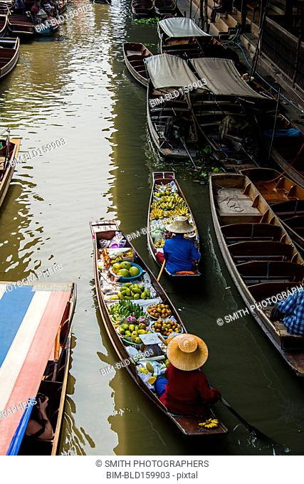 High angle view of merchants selling fruit in canoes