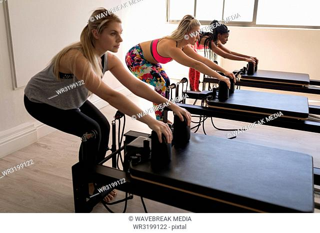 Group of women exercising on stretching machine