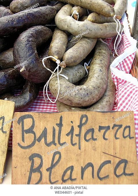 Butifarra blanca (dried sausage) for sale. Fira de Sant Ponç. Cataluña. Spain