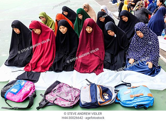 China, Hong Kong, Causeway Bay, Group of Indonesian Female Domestic Helpers Praying