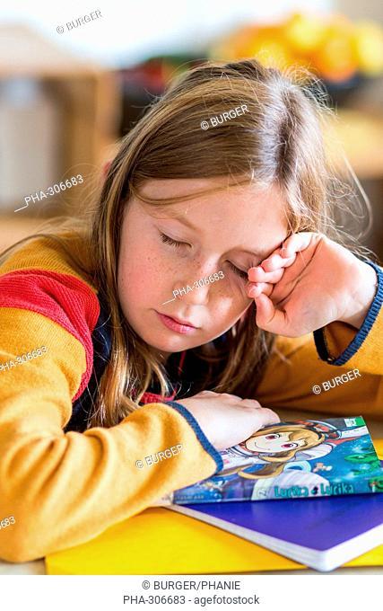 9-year-old girl doing her homework