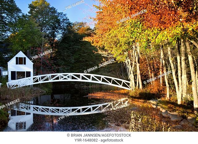 Footbridge across pond at the Mt Desert Island Historical Society building in Acadia National Park, Somesville Maine USA