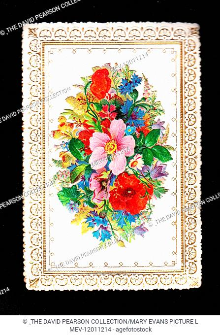 Arrangement of assorted flowers on a greetings card with ornate gold and white border