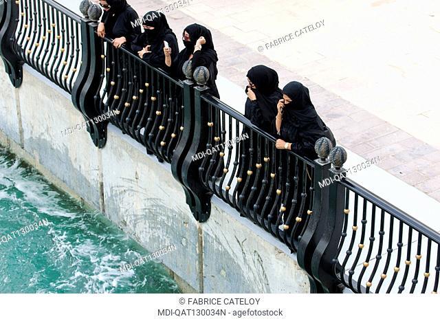 Qatar - Doha - The Pearl - Porto Arabia - Qatari women looking at jet ski on La Croisette