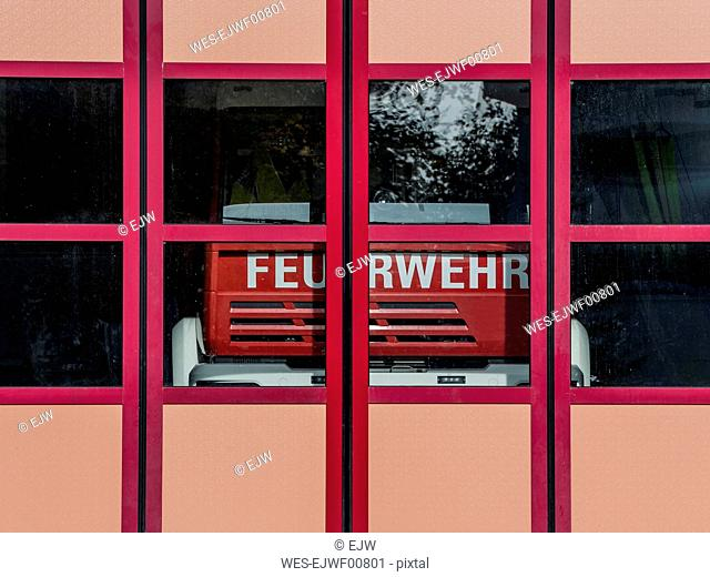 Fire engine behind closed doors of fire station