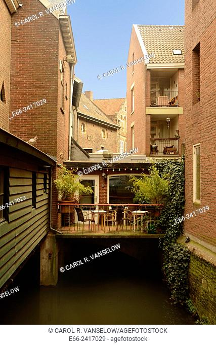 Small cafe behind the Bisschops Molen in the old city of Maastricht, overloooking one of the city's canals