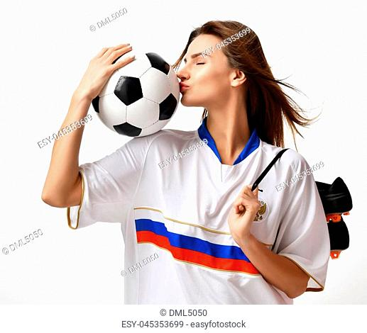 Fan sport woman player in russian uniform hold soccer ball celebrating kissing on white background