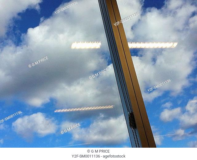 clouds and blue sky outside office window