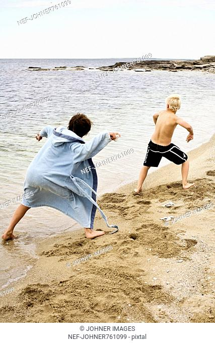 Two boys playing by the sea, Sweden