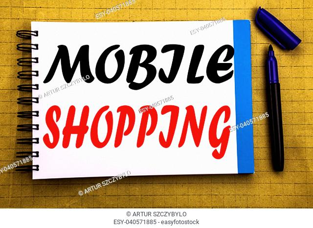 Mobile Shopping. Business concept for Cellphone online order Written on notepad paper background with space office view with pencil marker