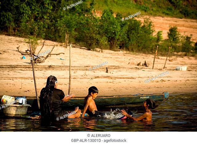 People Taking A shower in the River, Terra Preta Community, Cuieiras River, Amazônia, Manaus, Amazonas, Brazil