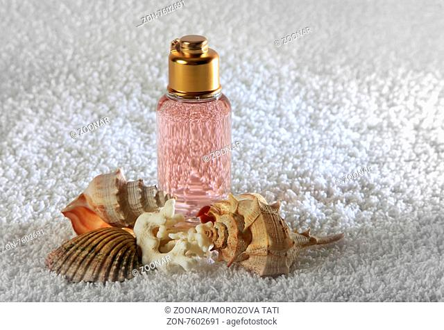 Accessories for a bath with cockleshells on a white background