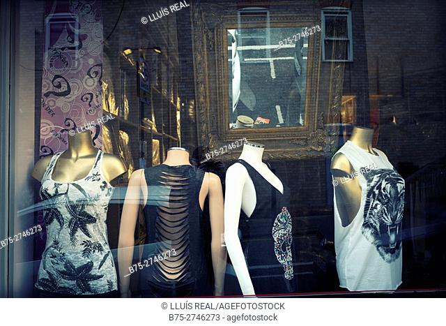 Shop window, clothing store, T-shirts. East End, London