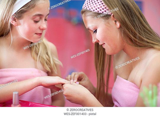 Two girls on a beauty farm pampering themselves