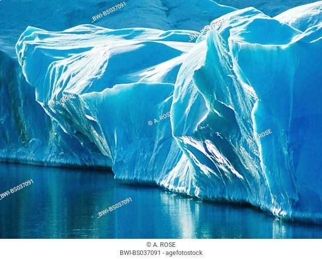 blue ice of a glacier, standing out of the water, Antarctica, Weddellmeer