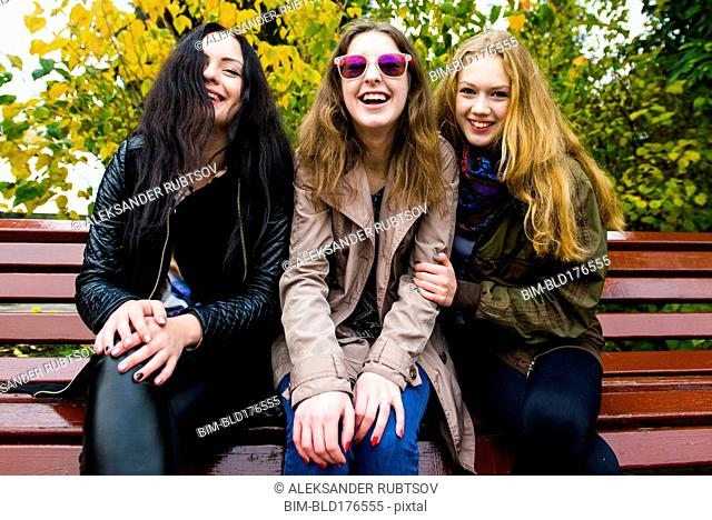 Caucasian women smiling on bench