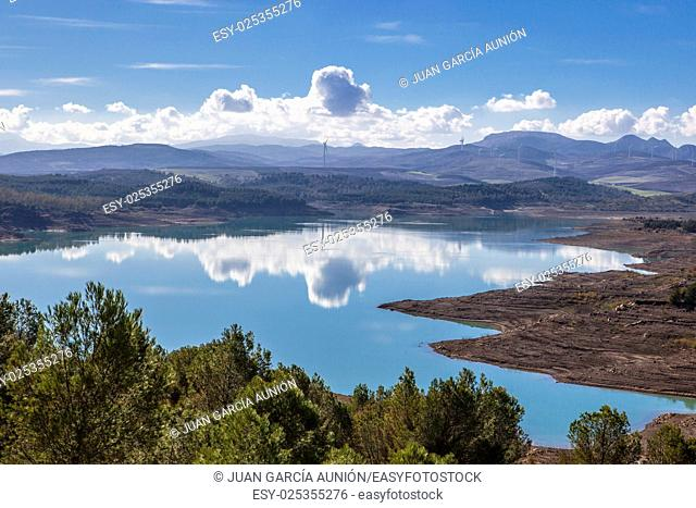 El Chorro reservoir landscape with windmills at bottom close to Gorge of the Gaitanes, Malaga, Spain