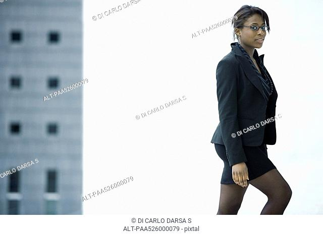 Businesswoman reaching top of stairs